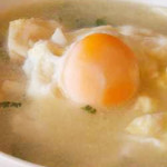 canja de bacalhau ao aroma com poejo e ovo escalfado